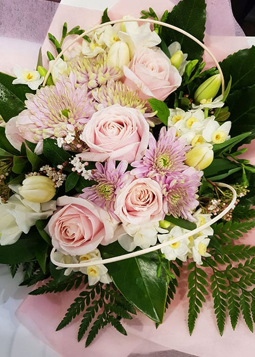 pink and white sympathy boxed flower arrangement